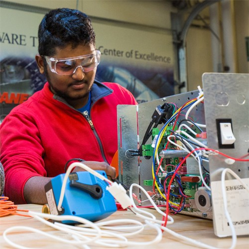 Energy student working on Automation systems with an instructor